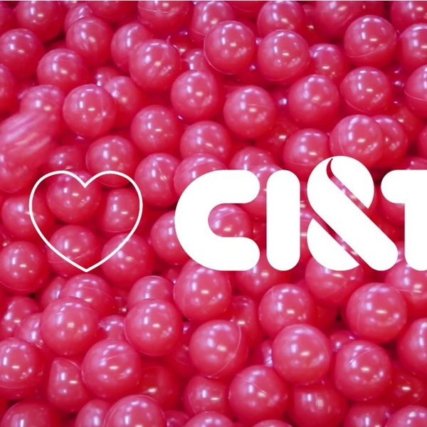 A red ball pit with the saying I love CI&T