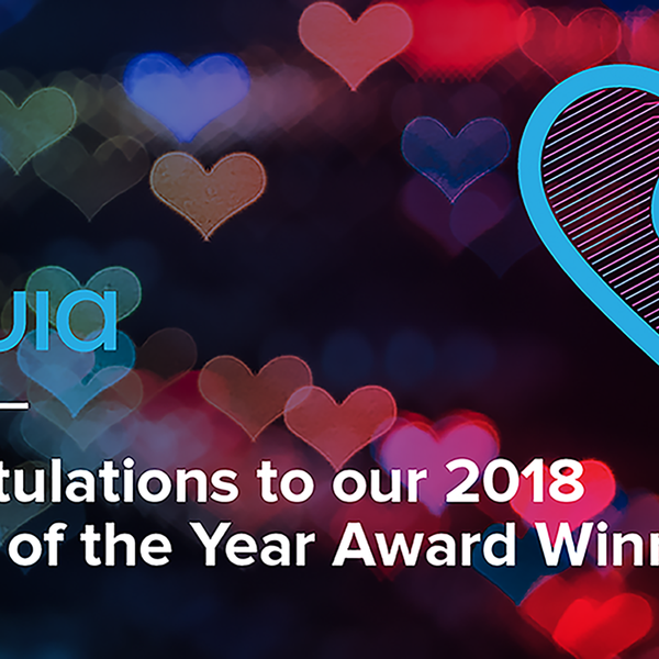 Acquia logo in a dark background full of colorfull hearts