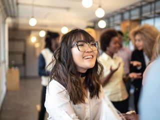 Asian woman with glasses smiling