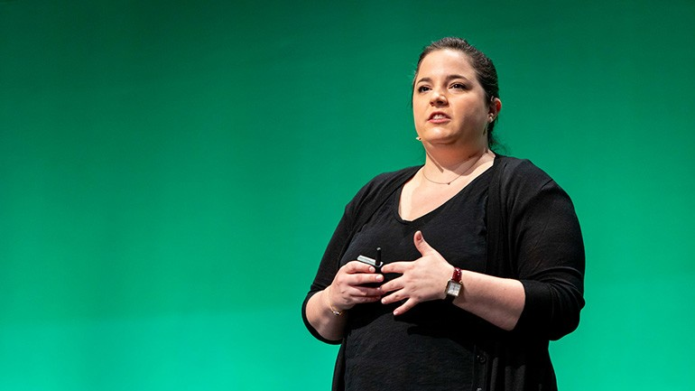 Michelle Beeson speaking on a stage