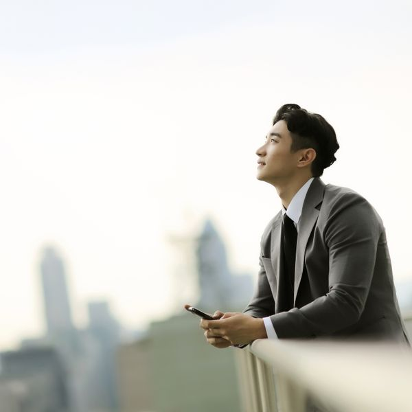 Businessman standing on city rooftop