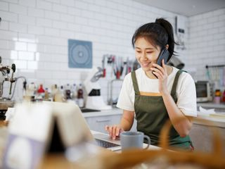Woman working and talking on cell phone