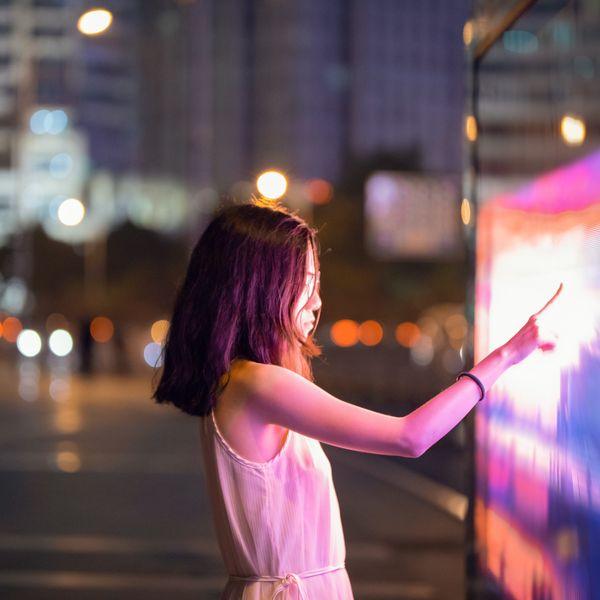 Woman touching colored screen