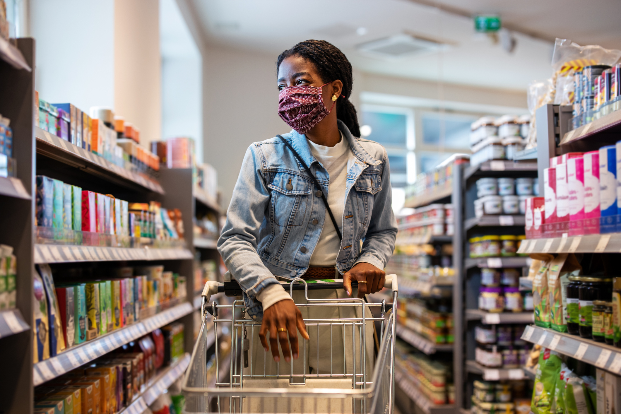 Woman at a grocery store wearing mask