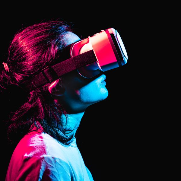 A woman using virtual reality headset in a dark room