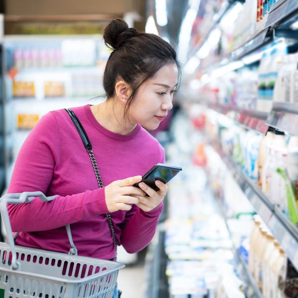 Asian woman shopping in supermarket