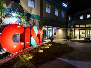 CI&T office entrance with big illuminated logo at night
