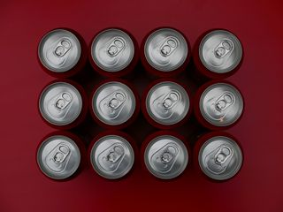 Drink cans on red background