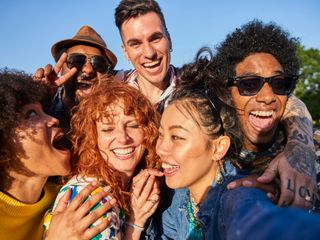 Group of friends from different ethnicities smiling