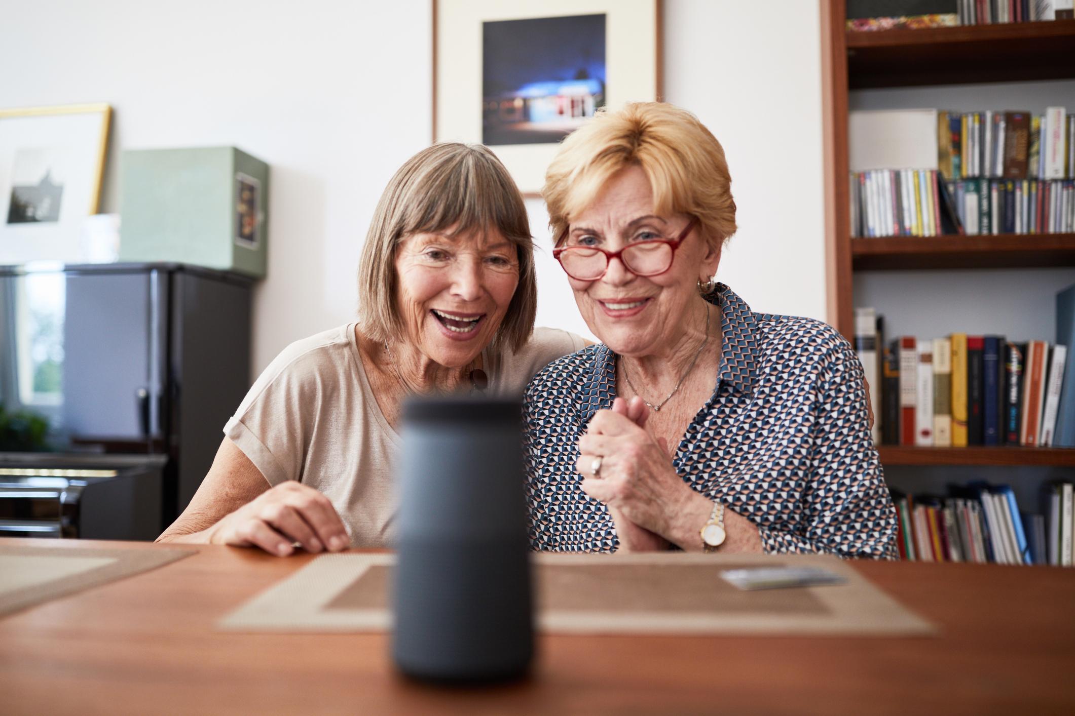 Senior women using a smart speaker