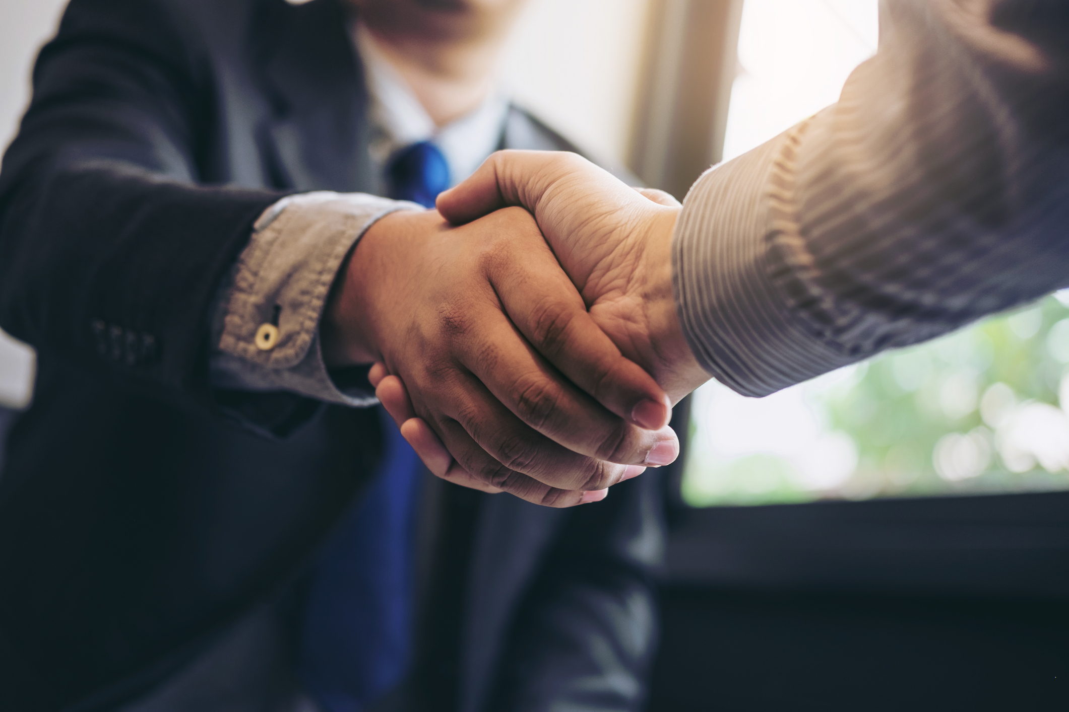 Two business men shaking hands during a meeting